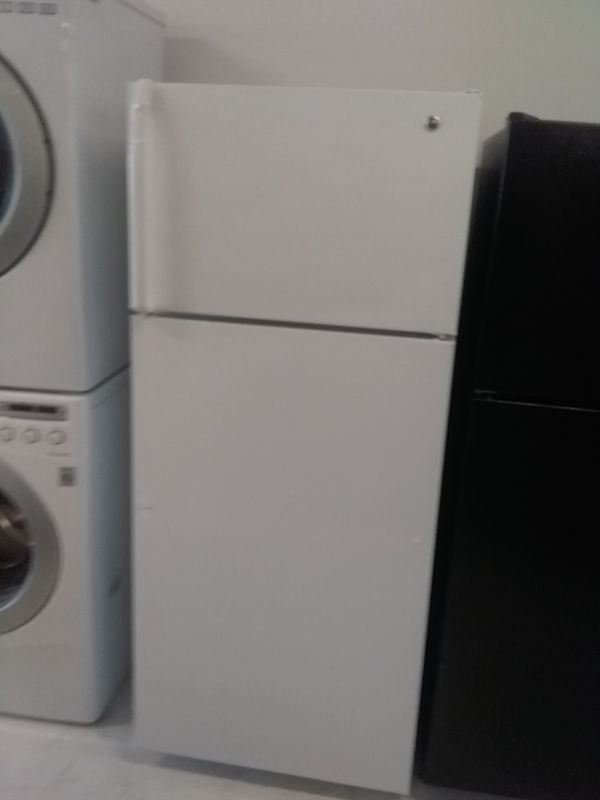 Ge top and bottom refrigerator used good condition 90 days warranty
