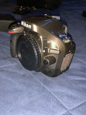 Nikon d5200 with 18-55 mm and 55-200 mm, and fish eye and wide angle attachment lenses, point and shoot camera thrown in, two chargers one battery for Sale in San Diego, CA