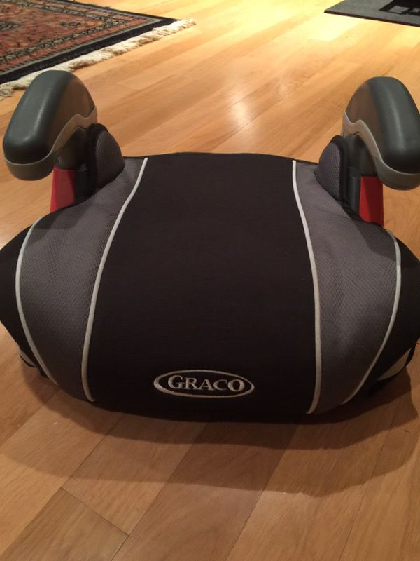 Booster seat by Graco with cup holders