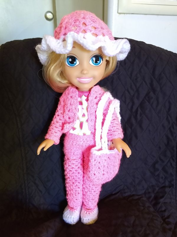 Doll with custom knitted clothes