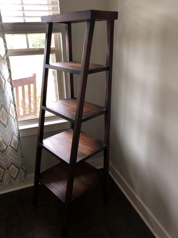 Brown wooden ladder storage shelf