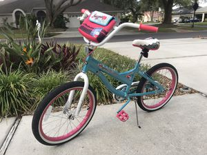 """Huffy girls bike. 20"""" tires. Seat is worn a bit (see picture) otherwise in fine condition. Has a handlebar bag that attaches or removed with Velcro for Sale in Odessa, FL"""