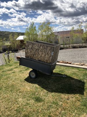 Small 2 wheel utility trailer with removable wooden sides. for Sale in Montrose, CO