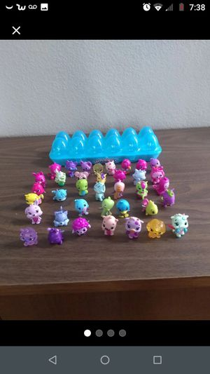 Hatchimals CollEGGtibles lot of 37 and blue case for Sale in San Jacinto, CA