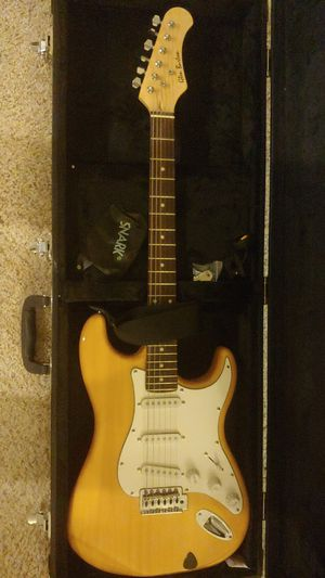Guitar with suitcase, strap and tuner for Sale in Wixom, MI