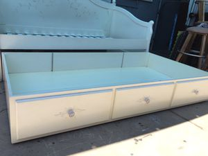 White Wooden Daybed and extra twin bed frame on the bottom. for Sale in Fresno, CA