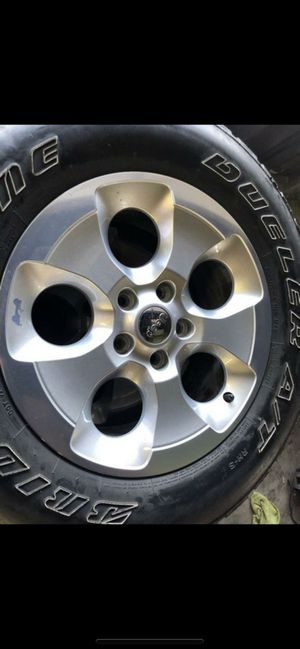 "For sale 4 Rims 18"" Jeep wrangler Sahara with tire for Sale in Montclair, CA"