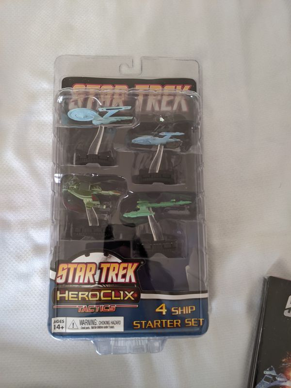 Various comic books and Star Trek HeroClix set.