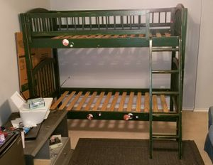 Solid Oak spindle twin over twin bunk bed. for Sale in Forney, TX
