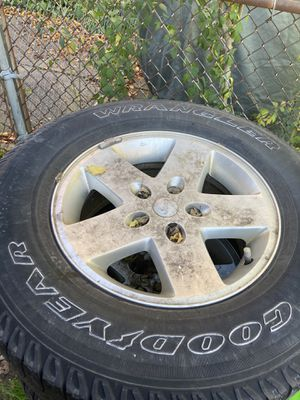 Jeep Wrangler Rims, tire tread is poor for Sale in Cleveland, OH