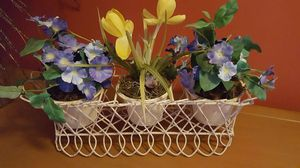 Distressed planter holder...Plant holder with silk flowers removable pots..16 w 12 t 5d ... this item was used for home staging purposes... for Sale in St. Louis, MO