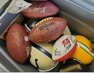SIGNED SPORTS COLLECTABLES. HELMETS, FOOTBALLS, BASEBALLS, JERSEYS. TONS OF BASEBALL CARDS AND OTHER SPORTS CARDS for Sale in Spring Hill, FL