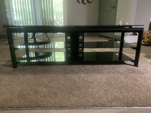 Black TV stand with black tempered glass for Sale in Melbourne, FL