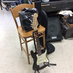 Squier Mini 3/4 Size Strat with Fender 10 Watt Amp, Guitar Cable, Strap and Gig Bag for Sale in Orange,  CA