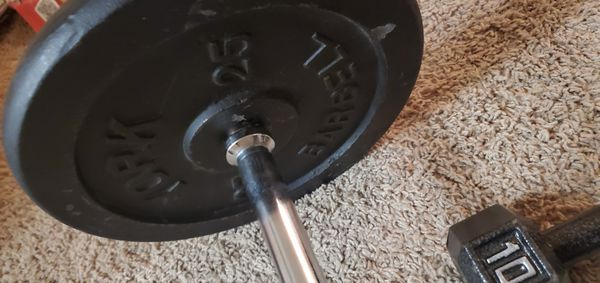 2. 25lb 2. 10s. One bar, and 35 pound dumbbells