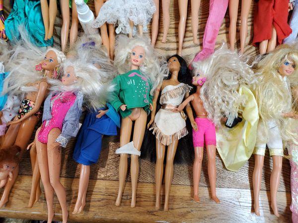 44 Barbie and Ken Dolls