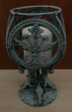 Unique metal candle holder with candle for Sale in Cottonwood Heights, UT