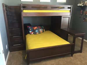 Bunk bed with bed that pulls out, desk and armoire. for Sale in Phoenix, AZ