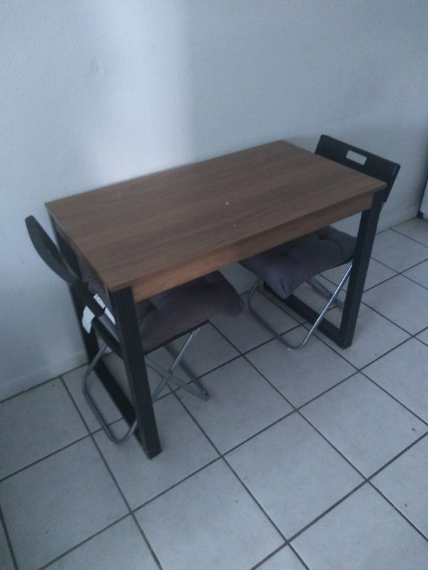 Small table with chairs movie / book shelf TV stand and couch