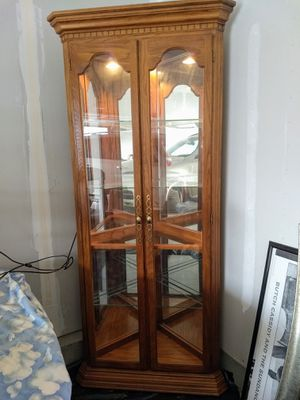 Solid wood curio cabinet for Sale in Sioux Falls, SD