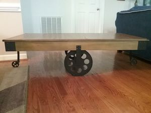 Factory cart wooden coffee table on wheels for Sale in Wake Forest, NC
