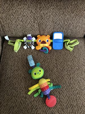 Bright Starts musical activity bar toy for baby stroller Includes baby rattle/ teether for Sale in St. Peters, MO