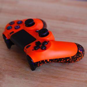 Orange Splat - DUAL SHOCK 4 - Wireless Bluetooth Custom PlayStation Controller - PS4 / PS3 / PC for Sale in Riverside, CA