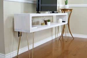 New white Mid Century Modern media table with gold hairpin legs for Sale in Spicewood, TX