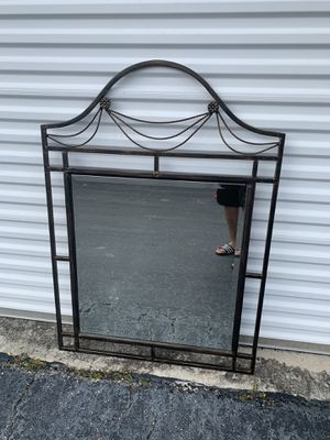Modern Metal Framed Bronze colored wall hanging hangable mirror! Great for the hall way or bedroom! Easy to hang, in great condition. Dimensions: 34 for Sale in Royal Palm Beach, FL