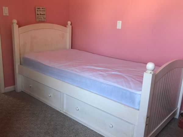 Twin bed with two drawers and twin mattress