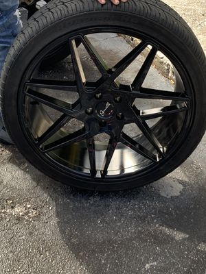 Black gianelle rims 22x9 tires are included for Sale in St. Petersburg, FL