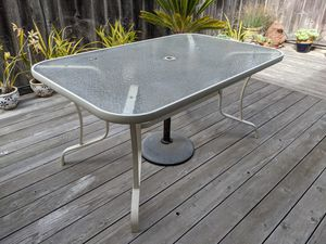 57x36.5 inches glass topped patio table. for Sale in Los Osos, CA