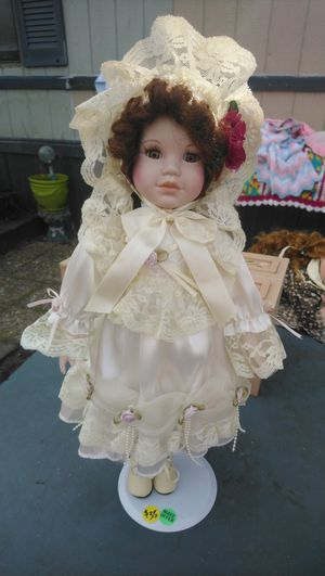 Brown hair porcelain doll for Sale in North Charleston, SC