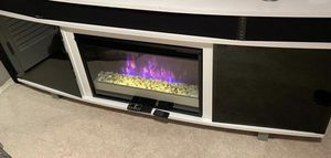This TV stand has fire place with different locks electric heater and surrounding speakers you can connected to the TV. 2 Remote controls. for Sale in Alexandria, VA
