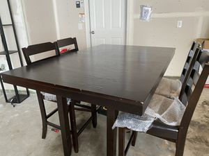 Dark Brown Dining Table (4 chairs) with extended leaf and bottom storage shelving for Sale in Brooklyn Center, MN