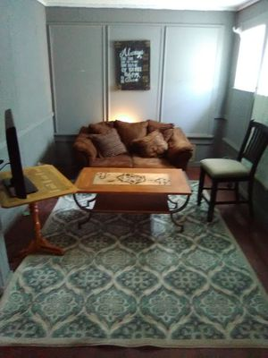 Couch, rug, hand painted signs and coffee table for Sale in Abilene, TX