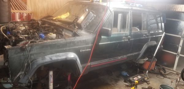 1995 jeep cherokee XJ- parts(mostly body and interior left)