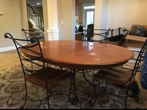 Wood & iron round table with extension and 5 chairs for Sale in Snohomish, WA