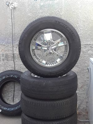 Set of used truck rims and tires two has like 50% on it and 2 no good rims are universal tires are 265/70/R18 for Sale in Fontana, CA