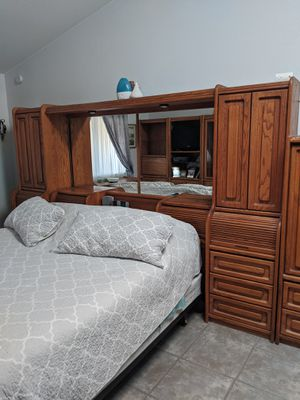 Solid Oak KING bedroom set. Not mattress/ box springs. Two upright piers connecting headboard, lighted bridge, mirrors, 3 upright storage pieces. for Sale in Phoenix, AZ
