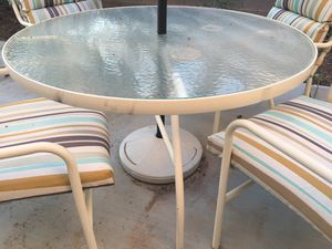 Reduced Price!! SALE!! Ready for entertaining Outdoor Glass Patio Table 4 Four Chairs with Matching Striped Comfy Cushions $110 OBO for Sale in Las Vegas, NV
