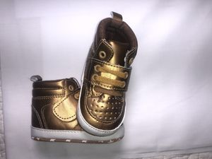 Baby Gold tennis shoes for Sale in Ayden, NC