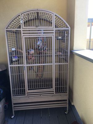 Bird 🦅 Cage it comes with the bird toys for Sale in Alameda, CA
