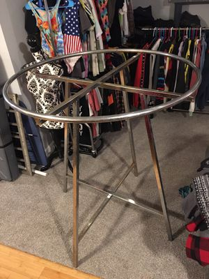 Large circular clothing rack, circle bar is removable And the supports fold down flat for Sale in Portland, OR