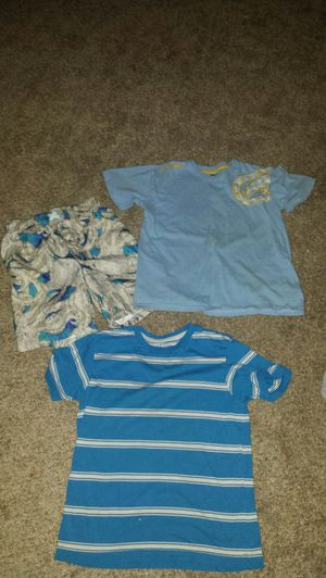 Boys bundle size 8. 2 shirts, and a pair of swim trunks for Sale in Waterloo, IA