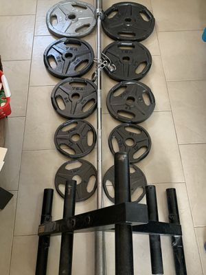Olympic weights 245 pounds total, and 45 pound barbell. Plus rack for Sale in Las Vegas, NV