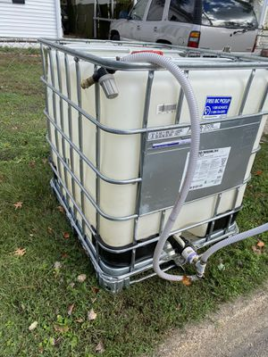100 gallon water tank with gravity hoes for Sale in Norfolk, VA