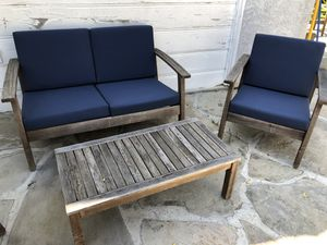 Pottery barn teak patio furniture set with matching cushions and cushion storage bin for Sale in Los Angeles, CA