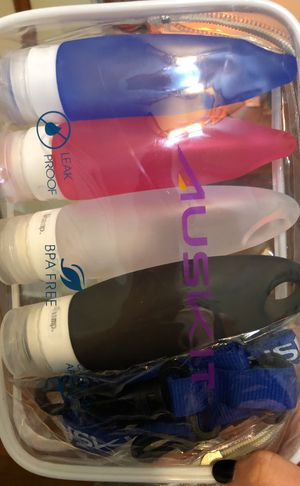 Portable toiletries containers with lanyard for Sale in Baltimore, MD