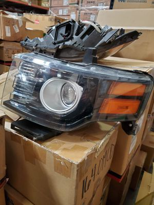 2009-12 Ford Flex left side headlight xenon black bezel for Sale in San Diego, CA